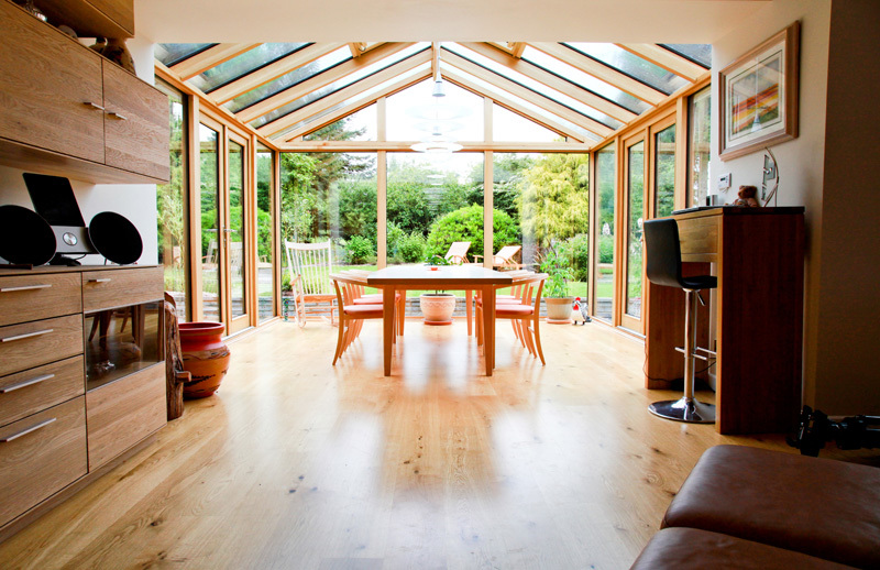 This oak conservatory design ensures natural light to the existing room of the house