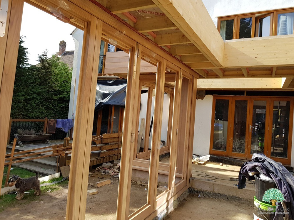 Orangery oak bifold doors during installation
