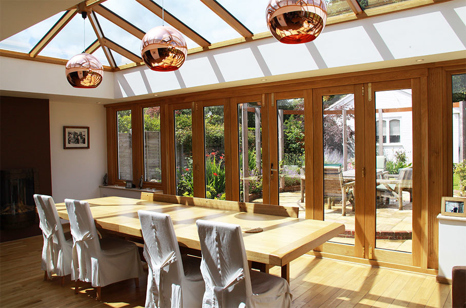 Hardwood orangery with seasoned oak bifold doors