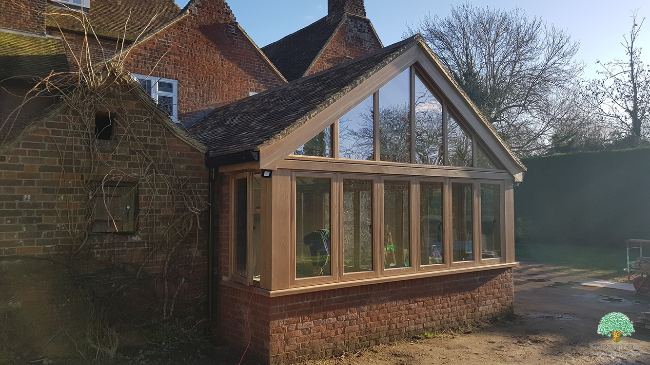 Seasoned oak garden room on a listed property in Kent