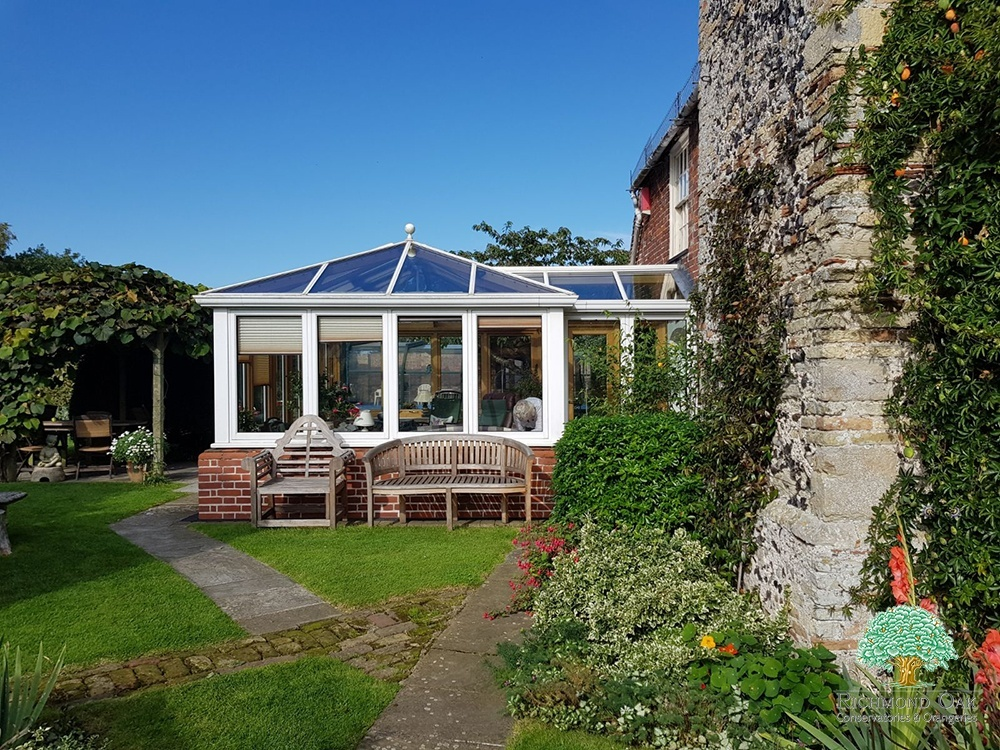 Listed Property wood conservatory with white painted exterior