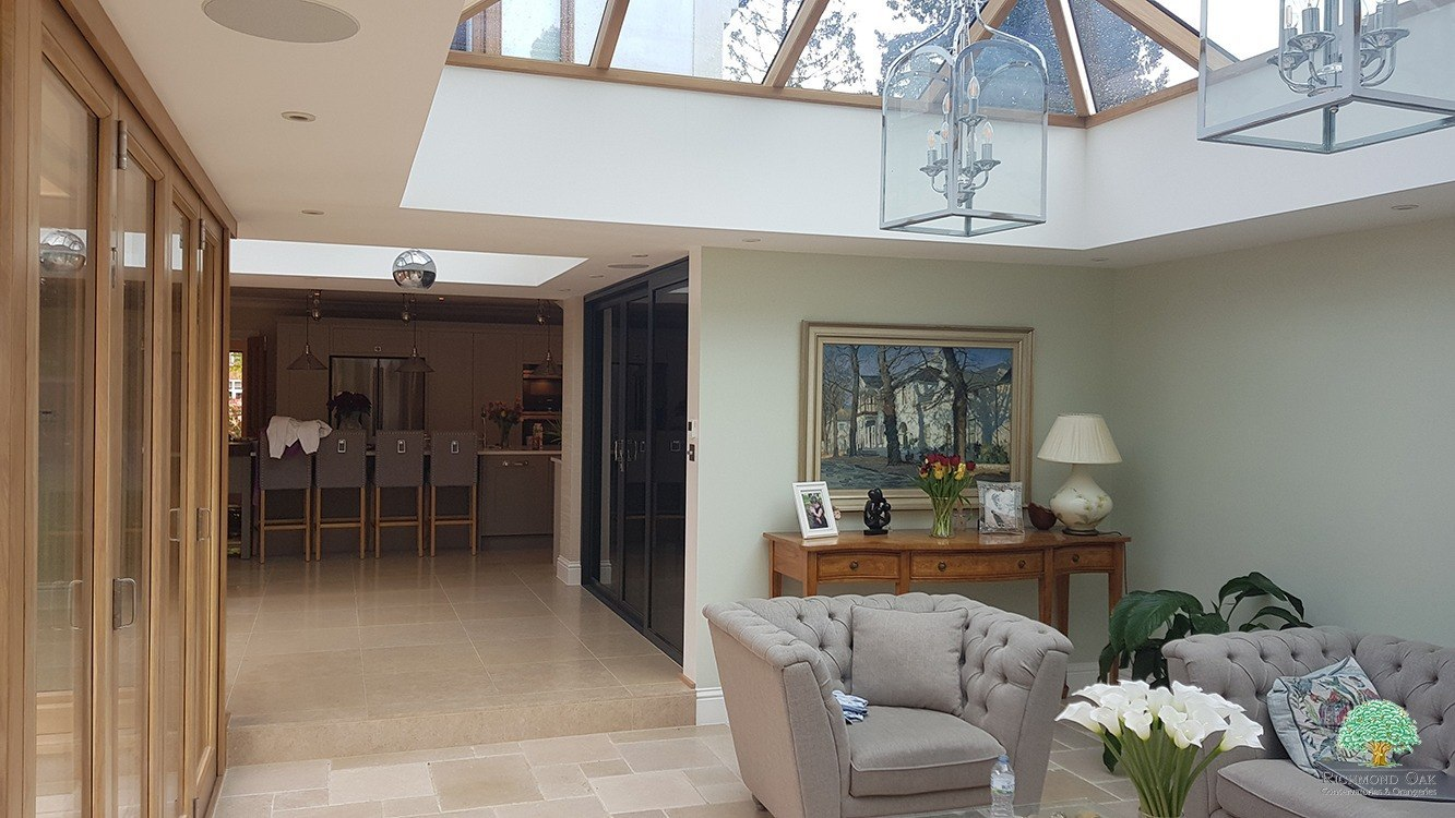 Wooden framed orangery with oak roof lantern and bifold doors